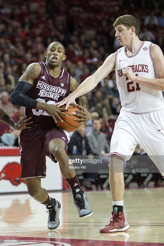 Hunter Mickelson #21 of the Arkansas Razorbacks tries to steal the ball from Craig Sword #32 of the Mississippi State Bulldogs at Bud Walton Arena on January 23, 2013 in Fayetteville, Arkansas. The Razorbacks defeated the Bulldogs 96-70.