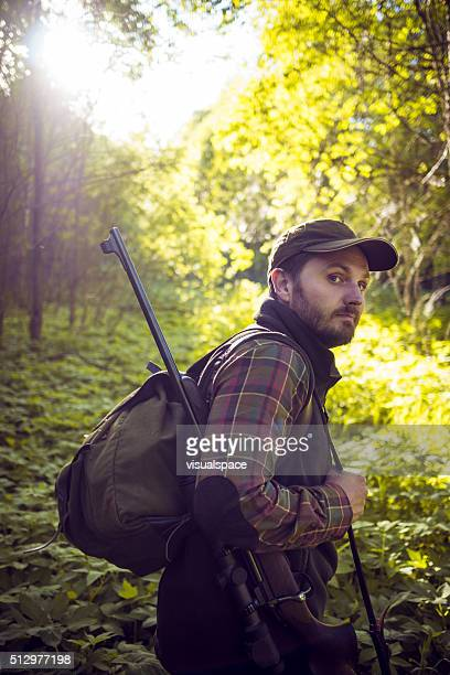Hunter on Adventure in a Sunny Forest