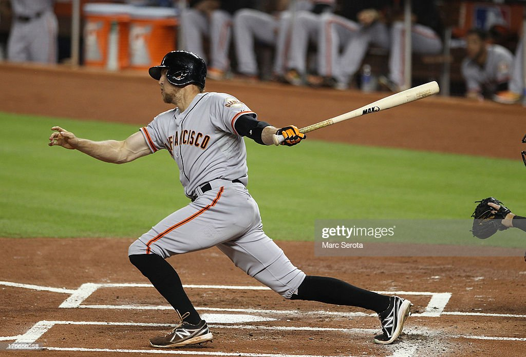 <a gi-track='captionPersonalityLinkClicked' href=/galleries/search?phrase=Hunter+Pence&family=editorial&specificpeople=757341 ng-click='$event.stopPropagation()'>Hunter Pence</a> 8 of the San Francisco Giants hits a two run single against the Miami Marlins during the first inning at Marlins Park on August 16, 2013 in Miami, Florida.