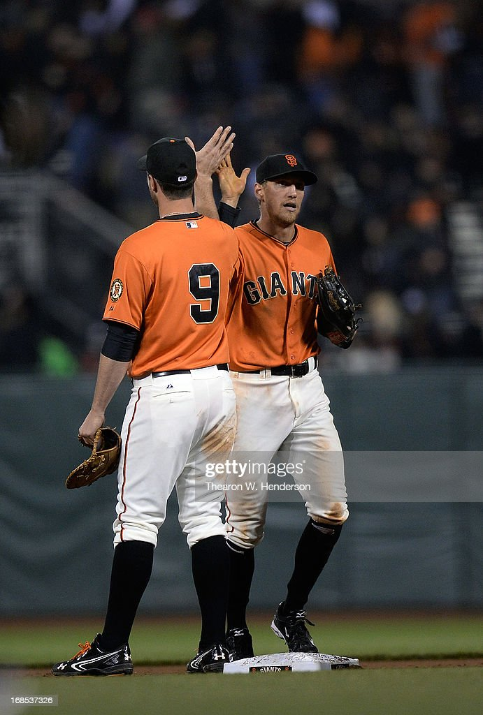 <a gi-track='captionPersonalityLinkClicked' href=/galleries/search?phrase=Hunter+Pence&family=editorial&specificpeople=757341 ng-click='$event.stopPropagation()'>Hunter Pence</a> #8 and <a gi-track='captionPersonalityLinkClicked' href=/galleries/search?phrase=Brandon+Belt&family=editorial&specificpeople=7513394 ng-click='$event.stopPropagation()'>Brandon Belt</a> #9 of the San Francisco Giants celebrates defeating the Atlanta Braves 8-2 at AT&T Park on May 10, 2013 in San Francisco, California.