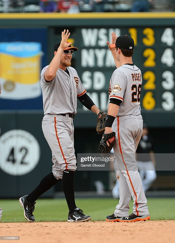 <a gi-track='captionPersonalityLinkClicked' href=/galleries/search?phrase=Hunter+Pence&family=editorial&specificpeople=757341 ng-click='$event.stopPropagation()'>Hunter Pence</a> #8 and <a gi-track='captionPersonalityLinkClicked' href=/galleries/search?phrase=Buster+Posey&family=editorial&specificpeople=4896435 ng-click='$event.stopPropagation()'>Buster Posey</a> #28 of the San Francisco Giants celebrate after beating the Colorado Rockies 5-2 at Coors Field on June 30, 2013 in Denver, Colorado.