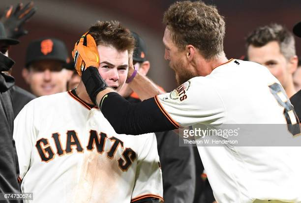 Hunter Pence and Christian Arroyo of the San Francisco Giants celebrates after Pences hit a walkoff sacrifice fly to score Gorkys Hernandez with the...