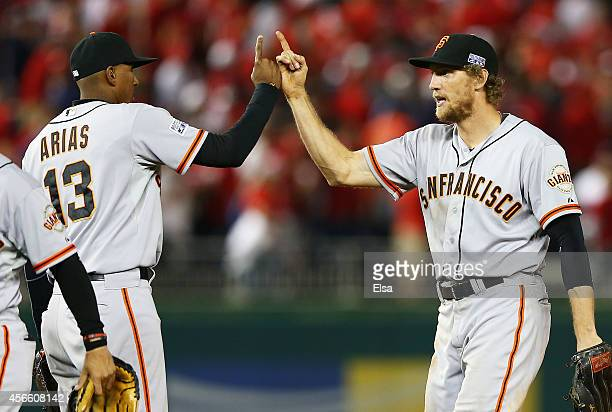 Hunter Pence and Joaquin Arias of the San Francisco Giants celebrate their 3 to 2 win over the Washington Nationals in Game One of the National...