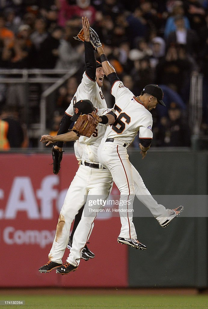 <a gi-track='captionPersonalityLinkClicked' href=/galleries/search?phrase=Hunter+Pence&family=editorial&specificpeople=757341 ng-click='$event.stopPropagation()'>Hunter Pence</a> #8, <a gi-track='captionPersonalityLinkClicked' href=/galleries/search?phrase=Andres+Torres&family=editorial&specificpeople=835839 ng-click='$event.stopPropagation()'>Andres Torres</a> #56 and <a gi-track='captionPersonalityLinkClicked' href=/galleries/search?phrase=Jeff+Francoeur&family=editorial&specificpeople=217574 ng-click='$event.stopPropagation()'>Jeff Francoeur</a> #23 of the San Francisco Giants celebrate defeating the Arizona Diamondbacks 4-3 at AT&T Park on July 20, 2013 in San Francisco, California.
