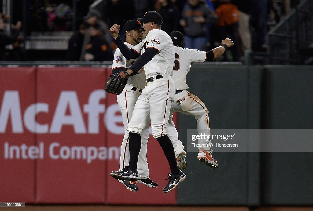 Hunter Pence #8, Angel Pagan #16 and Andres Torres #56 of the San Francisco Giants celebrate after defeating the Colorado Rockies 4-2 at AT&T Park on April 8, 2013 in San Francisco, California.