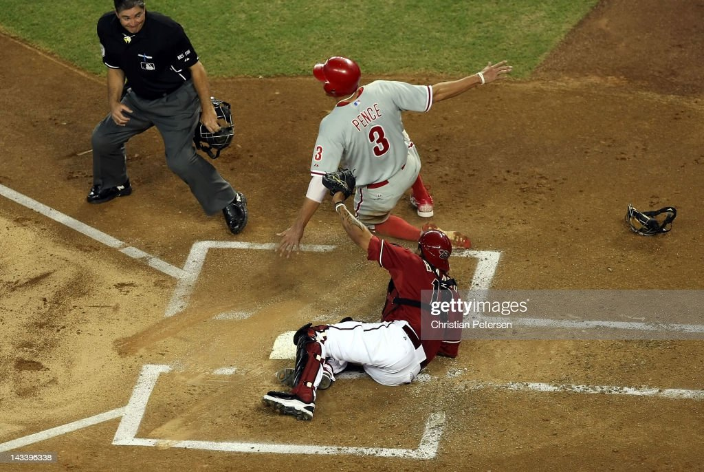 <a gi-track='captionPersonalityLinkClicked' href=/galleries/search?phrase=Hunter+Pence&family=editorial&specificpeople=757341 ng-click='$event.stopPropagation()'>Hunter Pence</a> #3 of the Philadelphia Phillies is tagged out at home plate by catcher <a gi-track='captionPersonalityLinkClicked' href=/galleries/search?phrase=Henry+Blanco&family=editorial&specificpeople=211366 ng-click='$event.stopPropagation()'>Henry Blanco</a> #12 of the Arizona Diamondbacks during the first inning of the MLB game at Chase Field on April 25, 2012 in Phoenix, Arizona. The Phillies defeated the Diamondbacks 7-2.