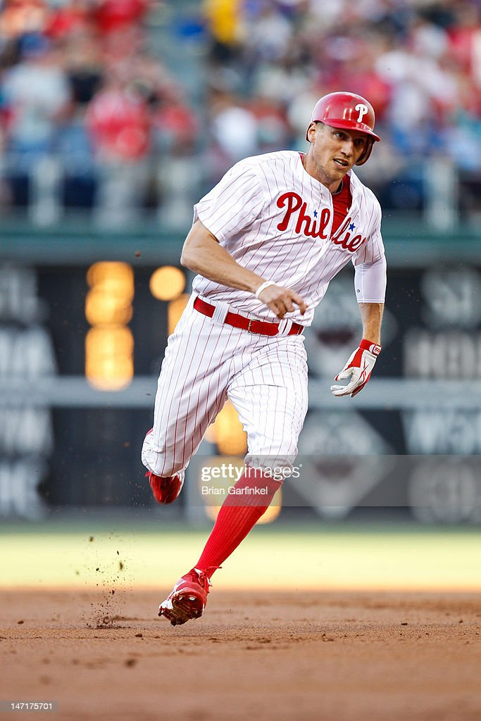 <a gi-track='captionPersonalityLinkClicked' href=/galleries/search?phrase=Hunter+Pence&family=editorial&specificpeople=757341 ng-click='$event.stopPropagation()'>Hunter Pence</a> #3 of the Philadelphia Phillies rounds second and is safe on third after a hit in the first inning of the game against the Pittsburgh Pirates at Citizens Bank Park on June 26, 2012 in Philadelphia, Pennsylvania.