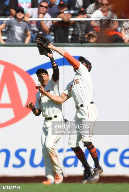 Hunter Pence of the San Francisco Giants avoids colliding with Gorkys Hernandez while catching a fly ball off the bat of Paul Goldschmidt of the...