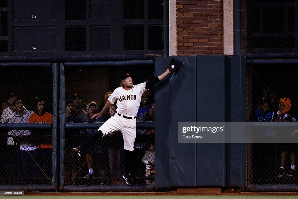 <a gi-track='captionPersonalityLinkClicked' href=/galleries/search?phrase=Hunter+Pence&family=editorial&specificpeople=757341 ng-click='$event.stopPropagation()'>Hunter Pence</a> #8 of the San Francisco Giants catches a ball hit by Jayson Werth #28 of the Washington Nationals for an out in the sixth inning during Game Four of the National League Division Series at AT&T Park on October 7, 2014 in San Francisco, California.