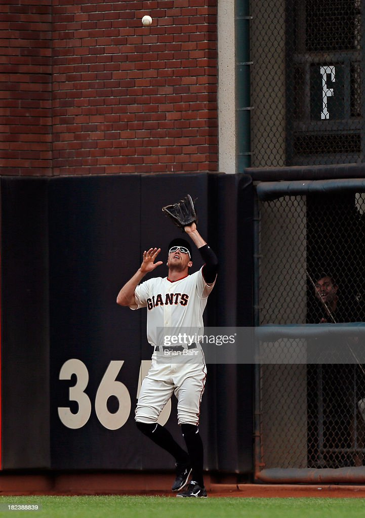 <a gi-track='captionPersonalityLinkClicked' href=/galleries/search?phrase=Hunter+Pence&family=editorial&specificpeople=757341 ng-click='$event.stopPropagation()'>Hunter Pence</a> #8 of the San Francisco Giants catches a fly ball against the San Diego Padres in the fourth inning at AT&T Park on September 29, 2013 in San Francisco, California. Pence started in all 161 games this season, and is the first Giant of the San Francisco era to start every regular season game.