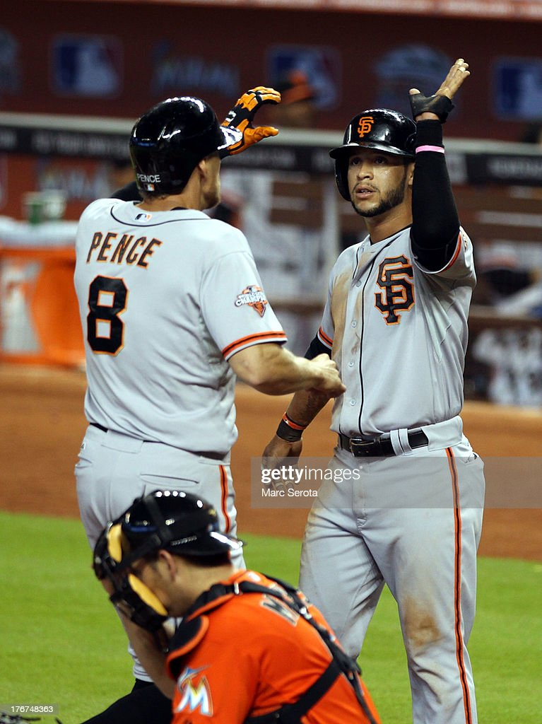 <a gi-track='captionPersonalityLinkClicked' href=/galleries/search?phrase=Hunter+Pence&family=editorial&specificpeople=757341 ng-click='$event.stopPropagation()'>Hunter Pence</a> #8 of the San Francisco Giants celebrates a two run home run in the second inning with teammate <a gi-track='captionPersonalityLinkClicked' href=/galleries/search?phrase=Gregor+Blanco&family=editorial&specificpeople=4137600 ng-click='$event.stopPropagation()'>Gregor Blanco</a> #7 against the Miami Marlins at Marlins Park on August 18, 2013 in Miami, Florida.