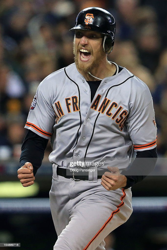 <a gi-track='captionPersonalityLinkClicked' href=/galleries/search?phrase=Hunter+Pence&family=editorial&specificpeople=757341 ng-click='$event.stopPropagation()'>Hunter Pence</a> #8 of the San Francisco Giants celebrates after scoring a run off of Brandon Belt #9 RBI against Max Scherzer #37 of the Detroit Tigers in the second inning during Game Four of the Major League Baseball World Series at Comerica Park on October 28, 2012 in Detroit, Michigan.