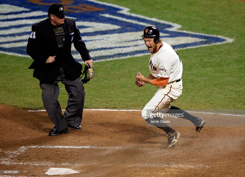 Hunter Pence #8 of the San Francisco Giants celebrates after scoring in the eighth inning off a hit by Juan Perez #2 against the Kansas City Royals during Game Five of the 2014 World Series at AT&T Park on October 26, 2014 in San Francisco, California.