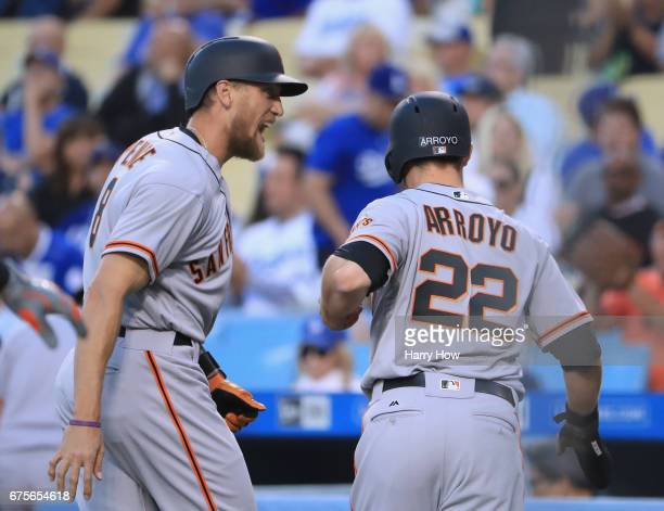 Hunter Pence of the San Francisco Giants celebrates his two run homerun with Christian Arroyo to take a 20 lead over the Los Angeles Dodgers during...