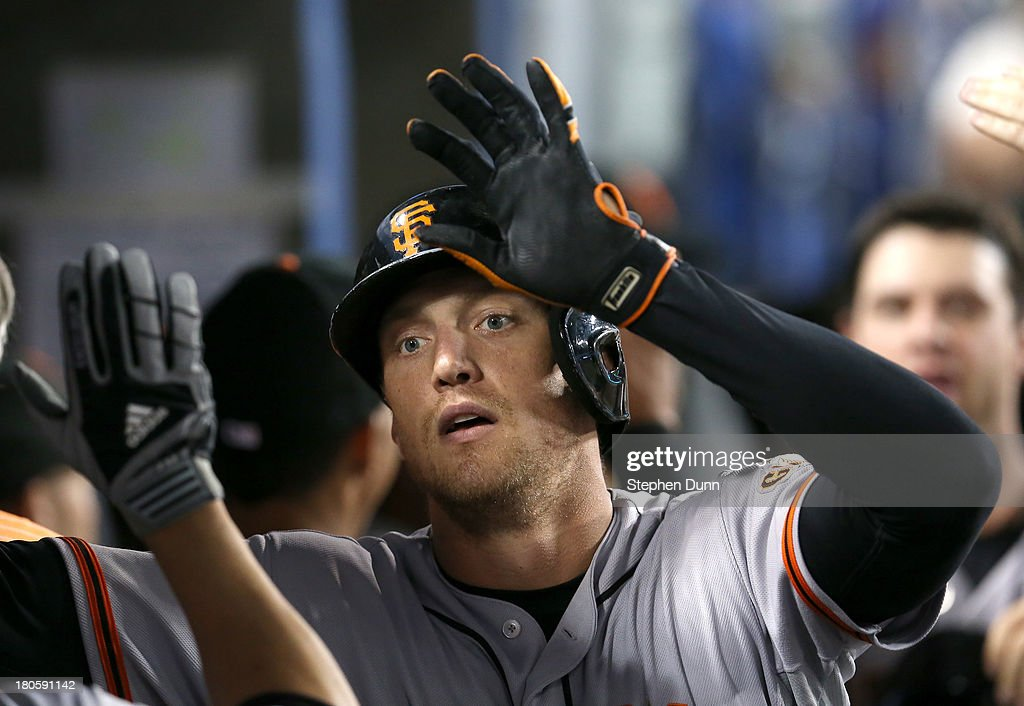 <a gi-track='captionPersonalityLinkClicked' href=/galleries/search?phrase=Hunter+Pence&family=editorial&specificpeople=757341 ng-click='$event.stopPropagation()'>Hunter Pence</a> #8 of the San Francisco Giants celebrates in the dugout after hitting a grand slam home run in the fifth inning against the Los Angeles Dodgers at Dodger Stadium on September 14, 2013 in Los Angeles, California.