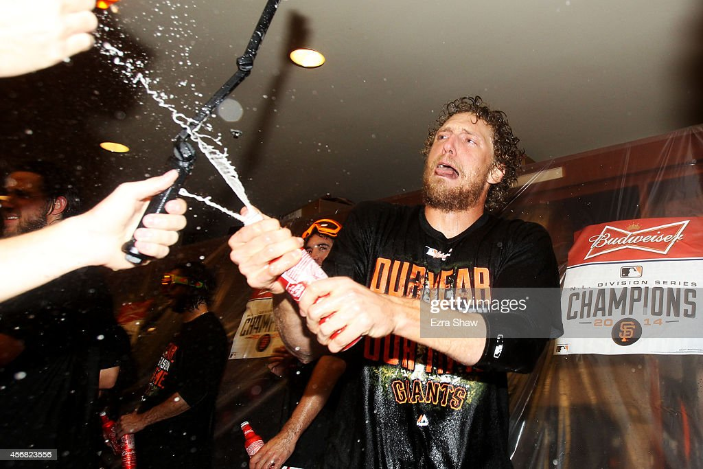 <a gi-track='captionPersonalityLinkClicked' href=/galleries/search?phrase=Hunter+Pence&family=editorial&specificpeople=757341 ng-click='$event.stopPropagation()'>Hunter Pence</a> #8 of the San Francisco Giants celebrates in the locker room after their 3 to 2 win over the Washington Nationals in Game Four of the National League Division Series at AT&T Park on October 7, 2014 in San Francisco, California.