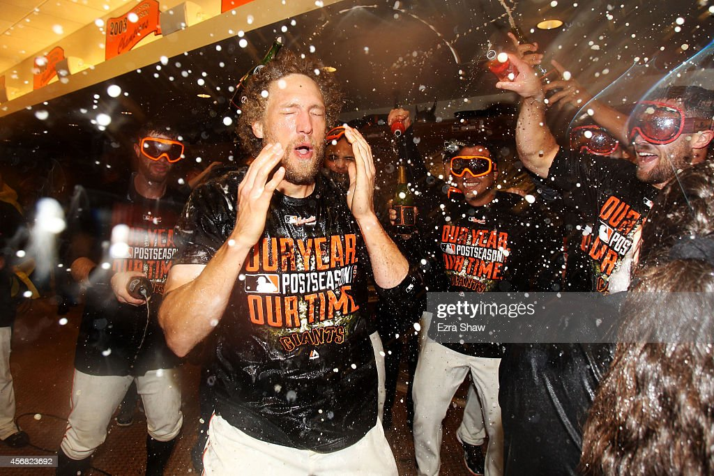 Hunter Pence #8 of the San Francisco Giants celebrates in the locker room after their 3 to 2 win over the Washington Nationals in Game Four of the National League Division Series at AT&T Park on October 7, 2014 in San Francisco, California.