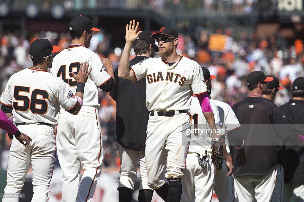 <a gi-track='captionPersonalityLinkClicked' href=/galleries/search?phrase=Hunter+Pence&family=editorial&specificpeople=757341 ng-click='$event.stopPropagation()'>Hunter Pence</a> #8 of the San Francisco Giants celebrates with <a gi-track='captionPersonalityLinkClicked' href=/galleries/search?phrase=Andres+Torres&family=editorial&specificpeople=835839 ng-click='$event.stopPropagation()'>Andres Torres</a> #56 after the game against the Atlanta Braves at AT&T Park on May 12, 2013 in San Francisco, California. The San Francisco Giants defeated the Atlanta Braves 5-1.