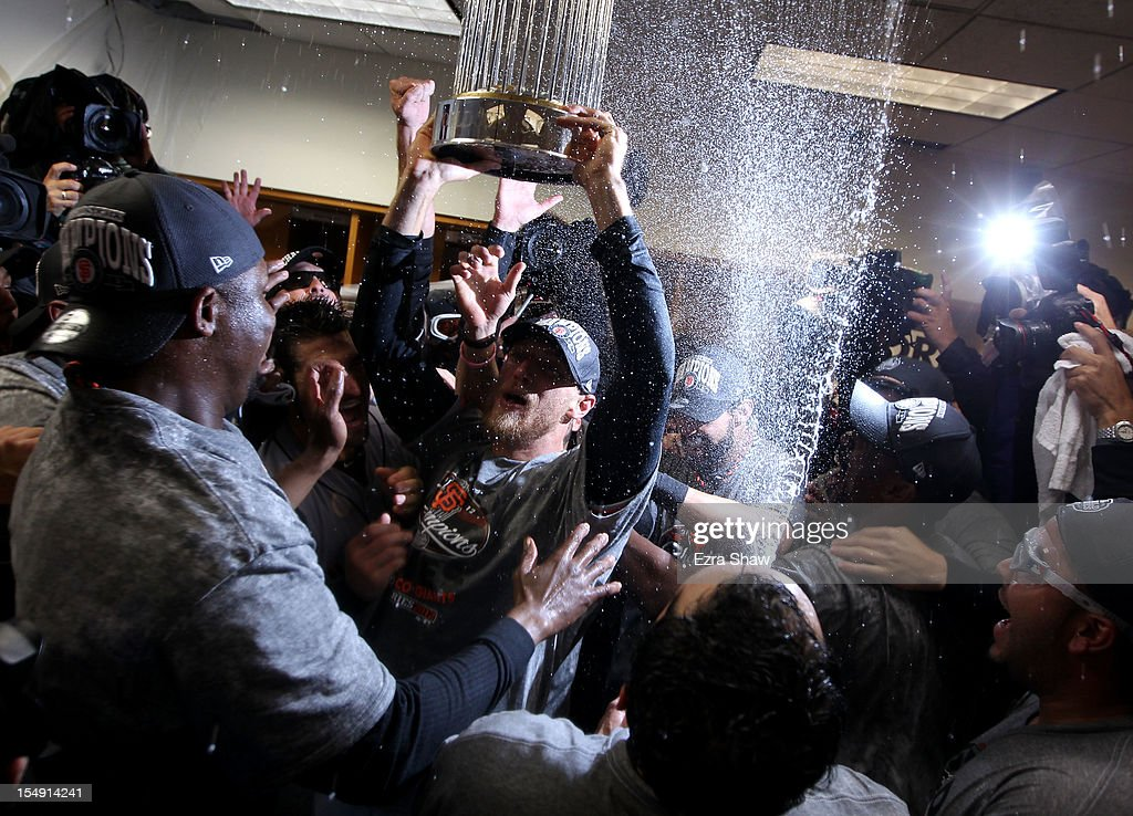 <a gi-track='captionPersonalityLinkClicked' href=/galleries/search?phrase=Hunter+Pence&family=editorial&specificpeople=757341 ng-click='$event.stopPropagation()'>Hunter Pence</a> #8 of the San Francisco Giants celebrates with his teammates and the Commissioner's Trophy in the lockeroom after defeating the Detroit Tigers to win Game Four of the Major League Baseball World Series at Comerica Park on October 28, 2012 in Detroit, Michigan. The San Francisco Giants defeated the Detroit Tigers 4-3 in the tenth inning to win the World Series in 4 straight games.