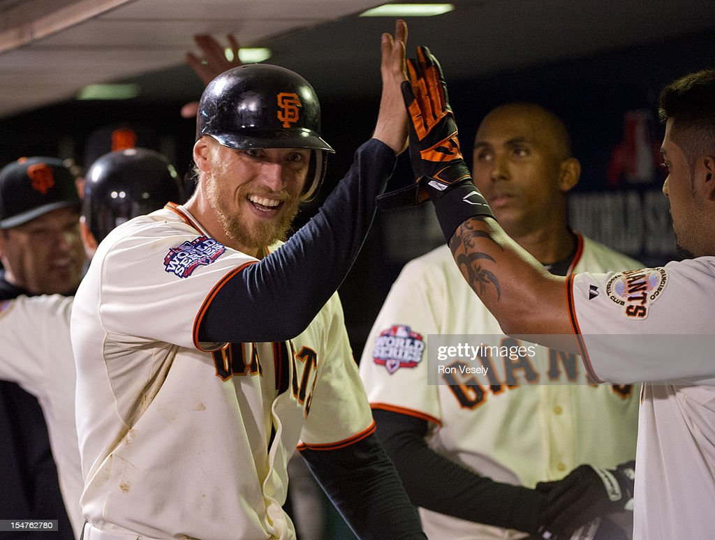 Hunter Pence #8 of the San Francisco Giants celebrates with teammates in the dugout after scoring in the bottom of the seventh inning of Game 2 of the 2012 World Series against the Detroit Tigers on Thursday, October 25, 2012 at AT&T Park in San Francisco, California.