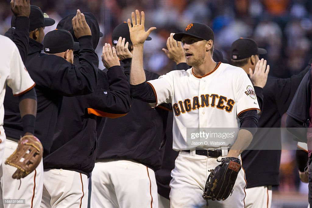 <a gi-track='captionPersonalityLinkClicked' href=/galleries/search?phrase=Hunter+Pence&family=editorial&specificpeople=757341 ng-click='$event.stopPropagation()'>Hunter Pence</a> #8 of the San Francisco Giants celebrates with teammates after the game against the Los Angeles Dodgers at AT&T Park on May 5, 2013 in San Francisco, California. The San Francisco Giants defeated the Los Angeles Dodgers 4-3.
