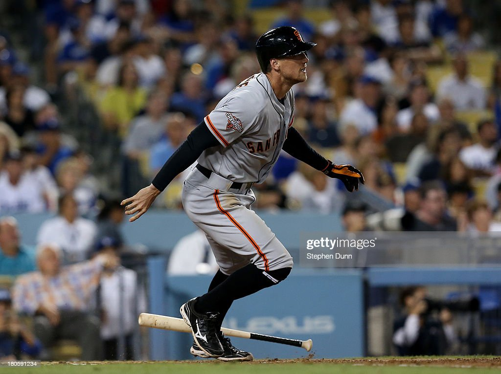 Hunter Pence #8 of the San Francisco Giants drops his bat as he watches his grand slam home run in the fifth inning against the Los Angeles Dodgers at Dodger Stadium on September 14, 2013 in Los Angeles, California.