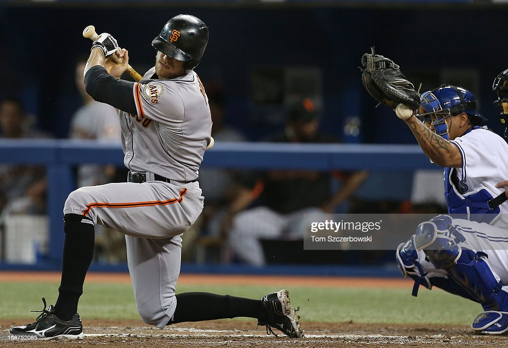 <a gi-track='captionPersonalityLinkClicked' href=/galleries/search?phrase=Hunter+Pence&family=editorial&specificpeople=757341 ng-click='$event.stopPropagation()'>Hunter Pence</a> #8 of the San Francisco Giants gets out of the way of an inside pitch during MLB game action as <a gi-track='captionPersonalityLinkClicked' href=/galleries/search?phrase=Henry+Blanco&family=editorial&specificpeople=211366 ng-click='$event.stopPropagation()'>Henry Blanco</a> #22 cannot handle a knuckleball from <a gi-track='captionPersonalityLinkClicked' href=/galleries/search?phrase=R.A.+Dickey&family=editorial&specificpeople=221719 ng-click='$event.stopPropagation()'>R.A. Dickey</a> #43 of the Toronto Blue Jays on May 14, 2013 at Rogers Centre in Toronto, Ontario, Canada.