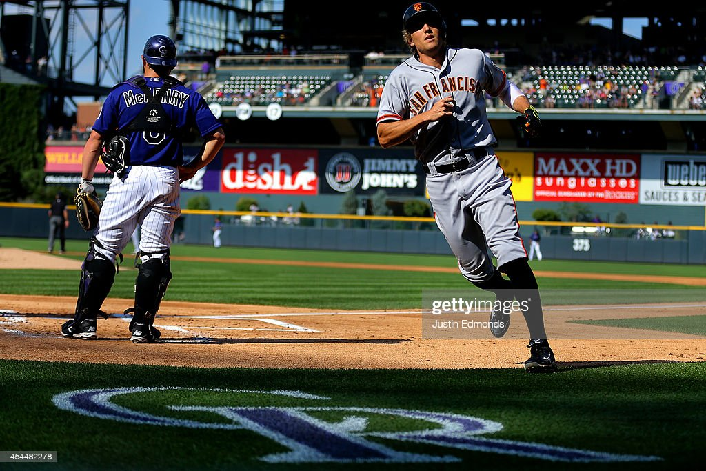 <a gi-track='captionPersonalityLinkClicked' href=/galleries/search?phrase=Hunter+Pence&family=editorial&specificpeople=757341 ng-click='$event.stopPropagation()'>Hunter Pence</a> #8 of the San Francisco Giants heads back to the dugout after scoring on his three-run home run during the first inning as catcher <a gi-track='captionPersonalityLinkClicked' href=/galleries/search?phrase=Michael+McKenry&family=editorial&specificpeople=4949028 ng-click='$event.stopPropagation()'>Michael McKenry</a> #8 of the Colorado Rockies stands behind the plate at Coors Field on September 1, 2014 in Denver, Colorado.