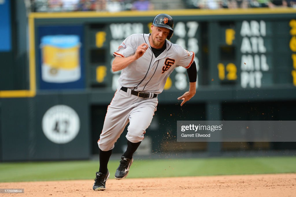 <a gi-track='captionPersonalityLinkClicked' href=/galleries/search?phrase=Hunter+Pence&family=editorial&specificpeople=757341 ng-click='$event.stopPropagation()'>Hunter Pence</a> #8 of the San Francisco Giants heads towards third base during the game against the Colorado Rockies at Coors Field on June 30, 2013 in Denver, Colorado.