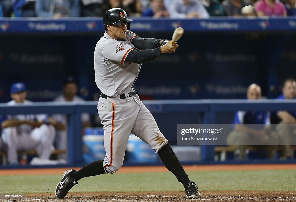 <a gi-track='captionPersonalityLinkClicked' href=/galleries/search?phrase=Hunter+Pence&family=editorial&specificpeople=757341 ng-click='$event.stopPropagation()'>Hunter Pence</a> #8 of the San Francisco Giants hits a double in the sixth inning during MLB game action against the Toronto Blue Jays on May 14, 2013 at Rogers Centre in Toronto, Ontario, Canada.