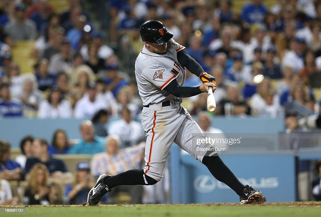 <a gi-track='captionPersonalityLinkClicked' href=/galleries/search?phrase=Hunter+Pence&family=editorial&specificpeople=757341 ng-click='$event.stopPropagation()'>Hunter Pence</a> #8 of the San Francisco Giants hits a grand slam home run in the fifth inning against the Los Angeles Dodgers at Dodger Stadium on September 14, 2013 in Los Angeles, California.