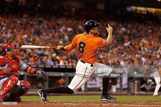 Hunter Pence of the San Francisco Giants hits a grand slam home run against the Philadelphia Phillies during the fourth inning at ATT Park on July 10...