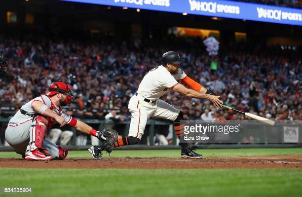 Hunter Pence of the San Francisco Giants hits a single that scored Kelby Tomlinson in the third inning against the Philadelphia Phillies at ATT Park...