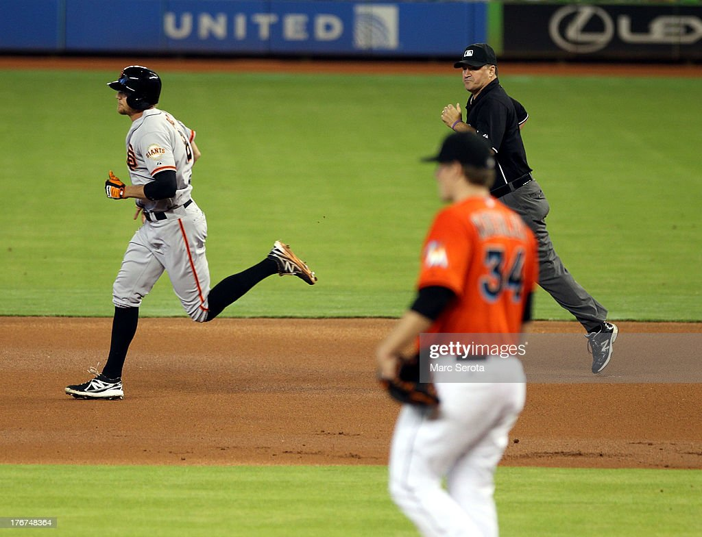 <a gi-track='captionPersonalityLinkClicked' href=/galleries/search?phrase=Hunter+Pence&family=editorial&specificpeople=757341 ng-click='$event.stopPropagation()'>Hunter Pence</a> #8 of the San Francisco Giants hits a two run home run in the second inning against the Miami Marlins at Marlins Park on August 18, 2013 in Miami, Florida.