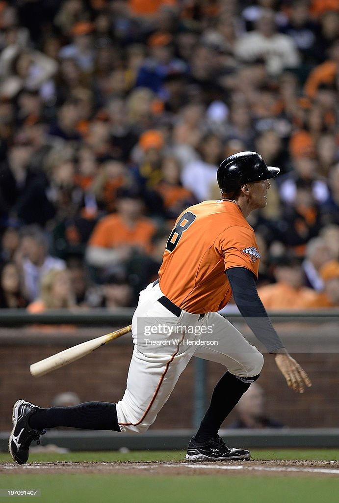 <a gi-track='captionPersonalityLinkClicked' href=/galleries/search?phrase=Hunter+Pence&family=editorial&specificpeople=757341 ng-click='$event.stopPropagation()'>Hunter Pence</a> #8 of the San Francisco Giants hits an RBI double, driving in Buster Posey (not pictured) from first base against the San Diego Padres in the third inning at AT&T Park on April 19, 2013 in San Francisco, California.