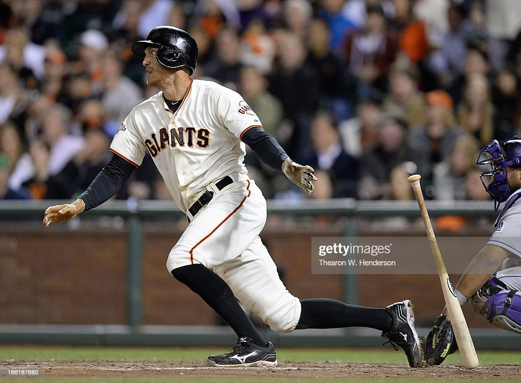 <a gi-track='captionPersonalityLinkClicked' href=/galleries/search?phrase=Hunter+Pence&family=editorial&specificpeople=757341 ng-click='$event.stopPropagation()'>Hunter Pence</a> #8 of the San Francisco Giants hits an RBI single driving in Nick Noonan #21 against the Colorado Rockies in the six inning at AT&T Park on April 9, 2013 in San Francisco, California.