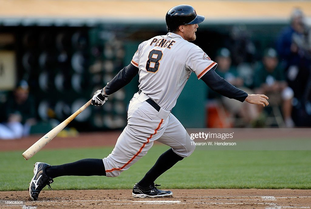 <a gi-track='captionPersonalityLinkClicked' href=/galleries/search?phrase=Hunter+Pence&family=editorial&specificpeople=757341 ng-click='$event.stopPropagation()'>Hunter Pence</a> #8 of the San Francisco Giants hits an RBI single driving in Marco Scutaro #19 during the first inning against the Oakland Athletics at O.co Coliseum on May 28, 2013 in Oakland, California.