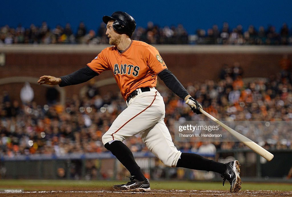 <a gi-track='captionPersonalityLinkClicked' href=/galleries/search?phrase=Hunter+Pence&family=editorial&specificpeople=757341 ng-click='$event.stopPropagation()'>Hunter Pence</a> #8 of the San Francisco Giants hits and infield single and gets an RBI driving in Pablo Sandoval #48 against the Atlanta Brave in the fourth inning at AT&T Park on May 10, 2013 in San Francisco, California.