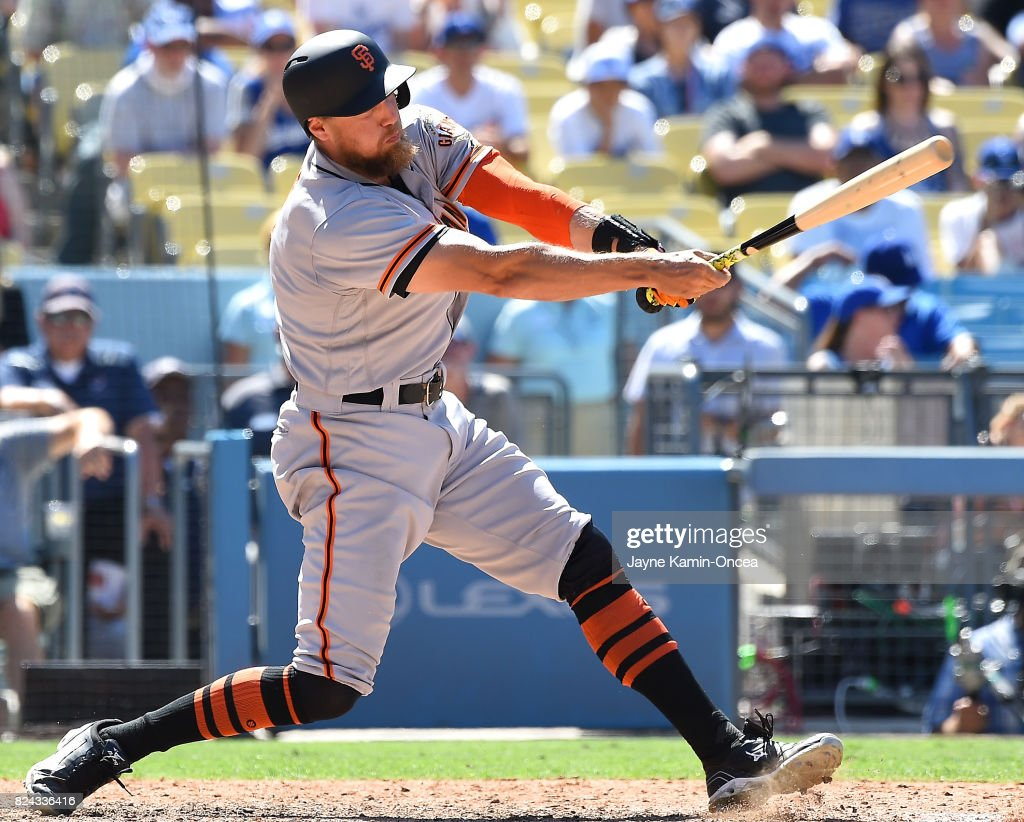 Hunter Pence #8 of the San Francisco Giants hits into a double play in the ninth inning of the game against the Los Angeles Dodgers at Dodger Stadium on July 29, 2017 in Los Angeles, California.