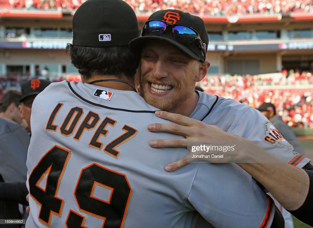 Hunter Pence #8 of the San Francisco Giants hugs Javier Lopez #49 after a win over the Cincinnati Reds in Game Five of the National League Division Series at the Great American Ball Park on October 11, 2012 in Cincinnati, Ohio. The Giants defeated the Reds 6-4.