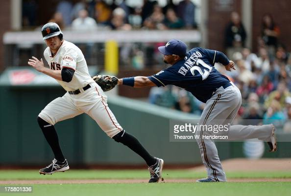 Hunter Pence of the San Francisco Giants is caught in a rundown and tagged out by first baseman Juan Francisco of the Milwaukee Brewers in the first...