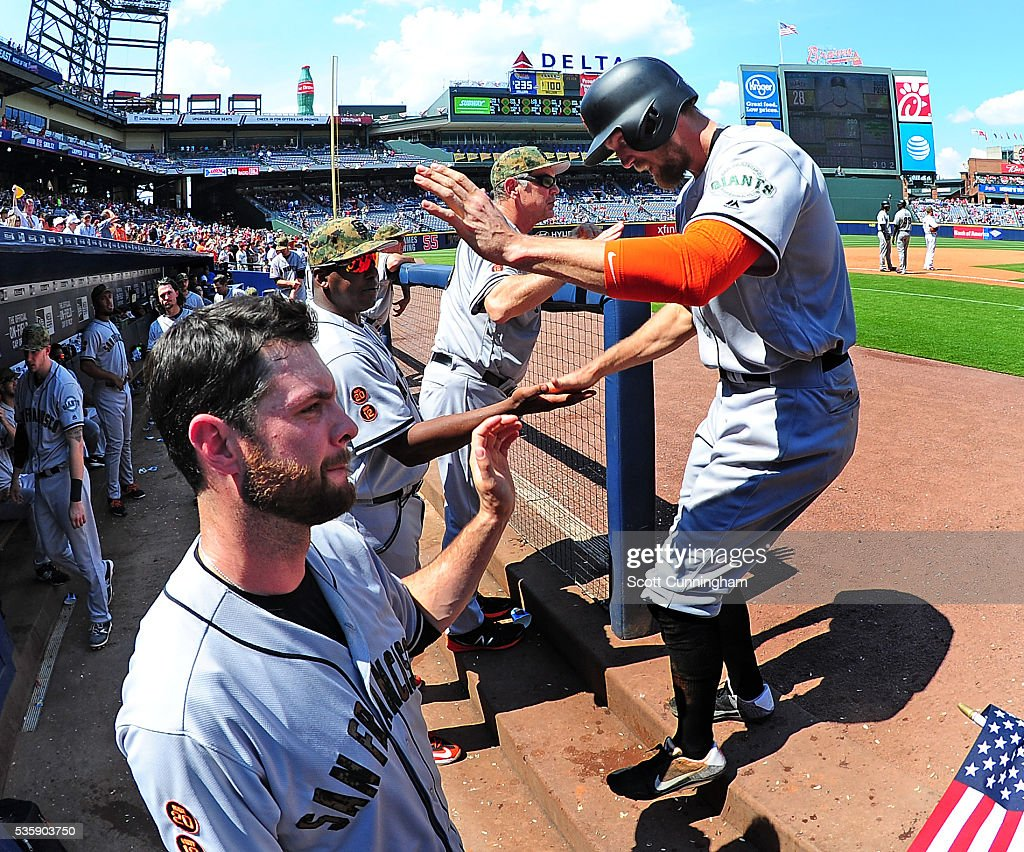 <a gi-track='captionPersonalityLinkClicked' href=/galleries/search?phrase=Hunter+Pence&family=editorial&specificpeople=757341 ng-click='$event.stopPropagation()'>Hunter Pence</a> #8 of the San Francisco Giants is congratulated by teammates after scoring a ninth inning run against the Atlanta Braves at Turner Field on May 30, 2016 in Atlanta, Georgia.
