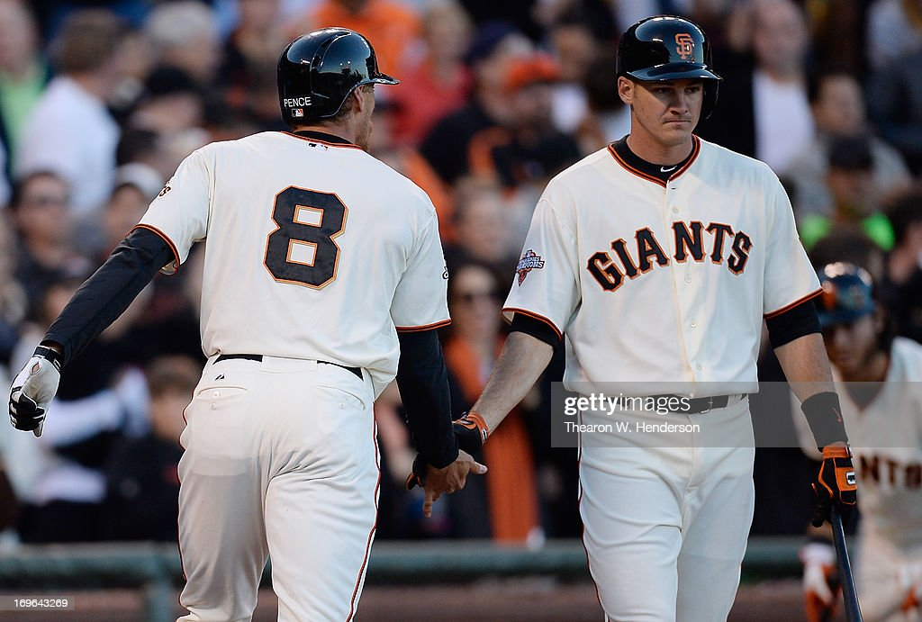 <a gi-track='captionPersonalityLinkClicked' href=/galleries/search?phrase=Hunter+Pence&family=editorial&specificpeople=757341 ng-click='$event.stopPropagation()'>Hunter Pence</a> #8 of the San Francisco Giants is congratulated by Brett Pill #6 after Pence hit a solo home run against the Oakland Athletics in the second inning at AT&T Park on May 29, 2013 in San Francisco, California.