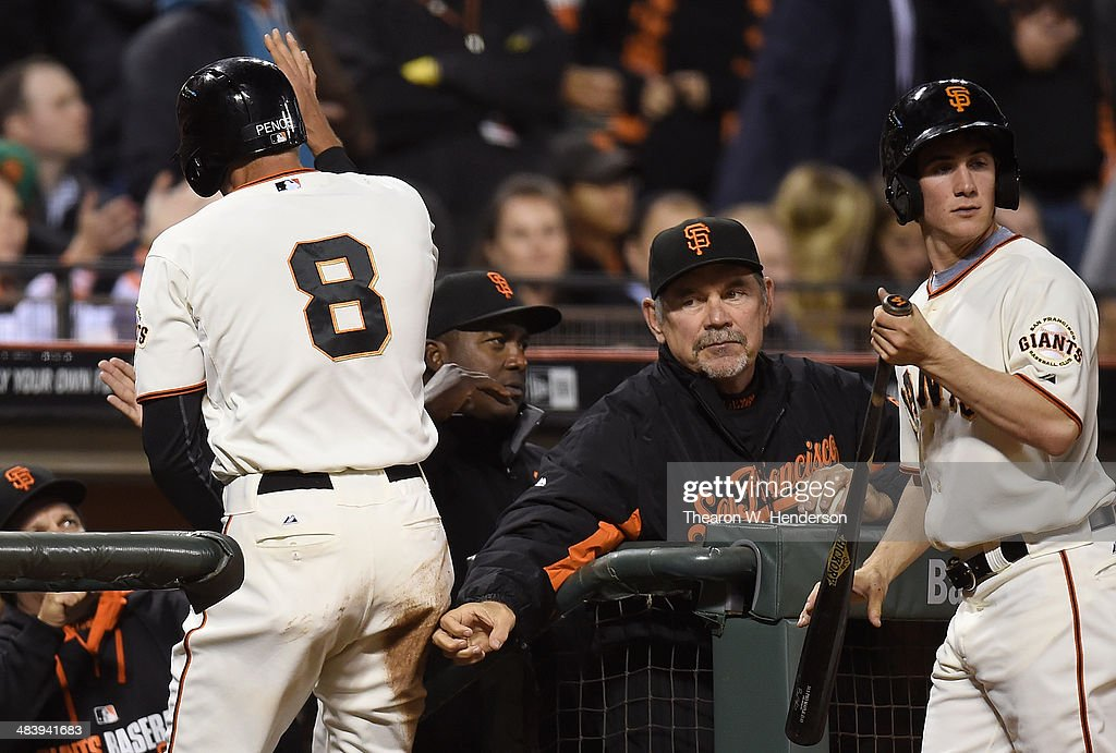 <a gi-track='captionPersonalityLinkClicked' href=/galleries/search?phrase=Hunter+Pence&family=editorial&specificpeople=757341 ng-click='$event.stopPropagation()'>Hunter Pence</a> #8 of the San Francisco Giants is congratulated by manager <a gi-track='captionPersonalityLinkClicked' href=/galleries/search?phrase=Bruce+Bochy&family=editorial&specificpeople=220291 ng-click='$event.stopPropagation()'>Bruce Bochy</a> #15 (R) after Pence scored against the Arizona Diamondbacks in the bottom of the second inning at AT&T Park on April 10, 2014 in San Francisco, California. Pence scored on an RBI single from Brandon Hicks.