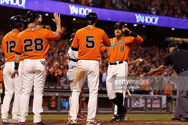 Hunter Pence of the San Francisco Giants is congratulated by Matt Duffy Buster Posey and Joe Panik after hitting a grand slam home run against the...
