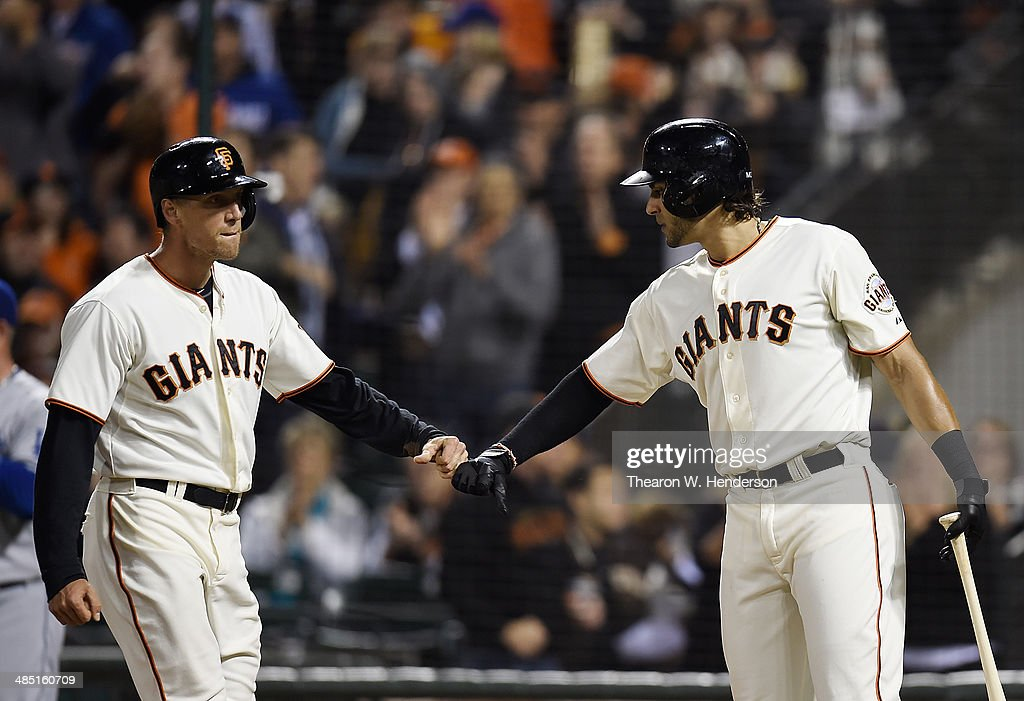 <a gi-track='captionPersonalityLinkClicked' href=/galleries/search?phrase=Hunter+Pence&family=editorial&specificpeople=757341 ng-click='$event.stopPropagation()'>Hunter Pence</a> #8 (L) of the San Francisco Giants is congratulated by Michael Morse #38 (R) after Pence scored in the bottom of the third inning against the Los Angeles Dodgers at AT&T Park on April 16, 2014 in San Francisco, California. Pence scored on an RBI single from Buster Posey.