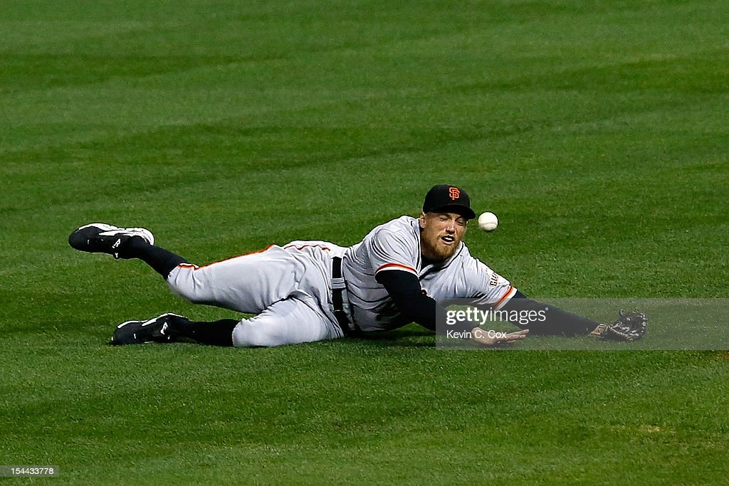 <a gi-track='captionPersonalityLinkClicked' href=/galleries/search?phrase=Hunter+Pence&family=editorial&specificpeople=757341 ng-click='$event.stopPropagation()'>Hunter Pence</a> #8 of the San Francisco Giants is unable to come up with a fly ball hit by David Freese #23 of the St. Louis Cardinals in the second inning in Game Five of the National League Championship Series at Busch Stadium on October 19, 2012 in St Louis, Missouri.