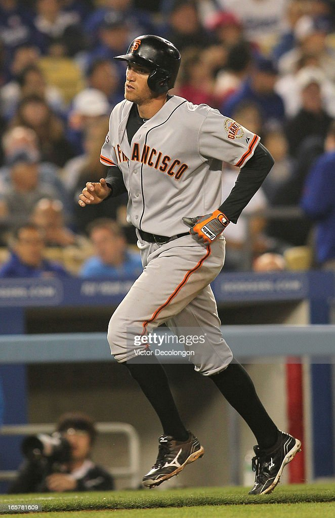 <a gi-track='captionPersonalityLinkClicked' href=/galleries/search?phrase=Hunter+Pence&family=editorial&specificpeople=757341 ng-click='$event.stopPropagation()'>Hunter Pence</a> #8 of the San Francisco Giants jogs toward homeplate after hitting a solo homerun in the sixth inning off pitcher Josh Beckett #61 of the Los Angeles Dodgers (not in photo) during the MLB game at Dodger Stadium on April 3, 2013 in Los Angeles, California. The Giants defeated the Dodgers 5-3.