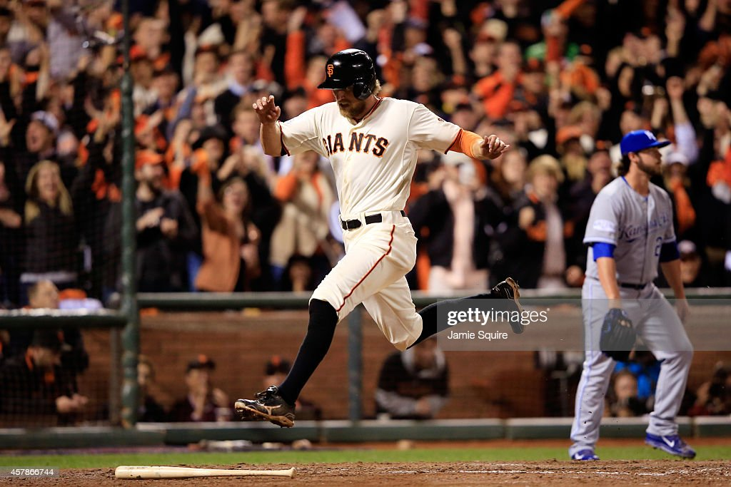 <a gi-track='captionPersonalityLinkClicked' href=/galleries/search?phrase=Hunter+Pence&family=editorial&specificpeople=757341 ng-click='$event.stopPropagation()'>Hunter Pence</a> #8 of the San Francisco Giants leaps over the bat of <a gi-track='captionPersonalityLinkClicked' href=/galleries/search?phrase=Brandon+Belt&family=editorial&specificpeople=7513394 ng-click='$event.stopPropagation()'>Brandon Belt</a> #9 after scoring on a Belt single in the sixth inning against the Kansas City Royals during Game Four of the 2014 World Series at AT&T Park on October 25, 2014 in San Francisco, California.