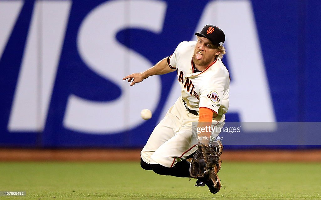 <a gi-track='captionPersonalityLinkClicked' href=/galleries/search?phrase=Hunter+Pence&family=editorial&specificpeople=757341 ng-click='$event.stopPropagation()'>Hunter Pence</a> #8 of the San Francisco Giants makes a diving catch on a ball hit by Lorenzo Cain #6 of the Kansas City Royals in the ninth inning during Game Four of the 2014 World Series at AT&T Park on October 25, 2014 in San Francisco, California.